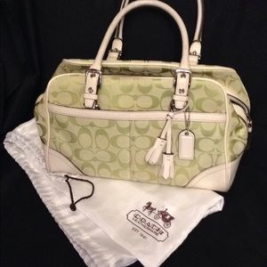 Coach white leather and pale green logo purse.